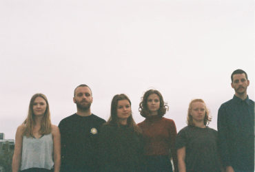 the members of concrete collective standing on a rooftop in the Adelaide CBD
